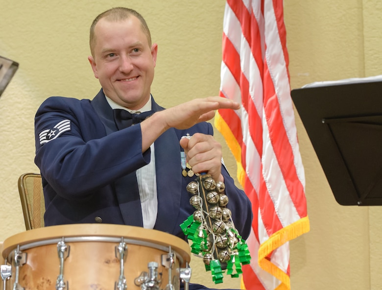 Staff Sgt. BJ Richard, The U.S. Air Force Band of the West, Nightwatch percussionist, performs with The U.S. Air Force Band of the West, Nightwatch,  during the Airman Leadership School graduation at the Bay Breeze Event Center Dec. 13, 2017, on Keesler Air Force Base, Mississippi. During the two-day visit to Keesler the band performed for Airmen and local residents throughout various locations at Keesler and the nearby area. Their mission is to honor military heritage through music, connect with the American public and inspire patriotism and excellence. (U.S. Air Force photo by André Askew)