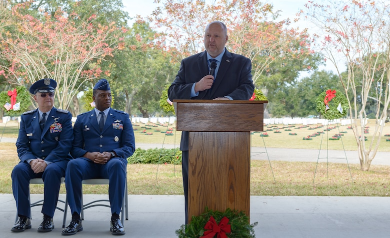 U.S. Army retired Chief Warrant Officer Shawn Hamner, Biloxi National Cemetery director, delivers comments during the Wreaths Across America ceremony at the Biloxi National Cemetery Dec. 16, 2017, in Biloxi, Mississippi. Wreaths Across America, a non-profit organization, was formed as an extension of the Arlington Wreath Project. The Arlington Wreath program was started by Morrill Worcester in 1992 with the donation and laying of 5000 Christmas wreaths to Arlington National Cemetery. (U.S. Air Force photo by André Askew)