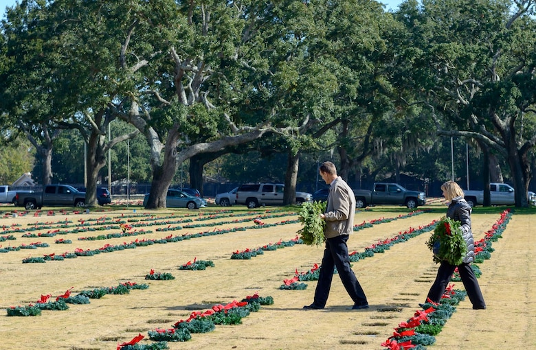 Local volunteers place wreaths at headstones during the Wreaths Across America ceremony at the Biloxi National Cemetery Dec. 16, 2017, in Biloxi, Mississippi. Wreaths Across America, a non-profit organization, was formed as an extension of the Arlington Wreath Project. The Arlington Wreath program was started by Morrill Worcester in 1992 with the donation and laying of 5000 Christmas wreaths to Arlington National Cemetery. Keesler leadership attended the event. (U.S. Air Force photo by André Askew)