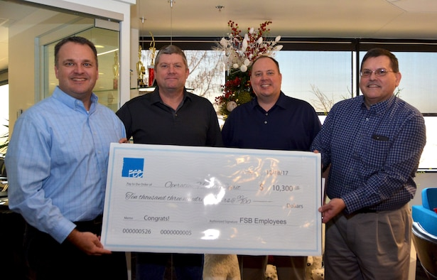 The employees of Frankfurt-Short-Bruza Architects and Engineers in Oklahoma City donated more than $10,000 Dec. 18, 2017, to Operation Holiday Spirit, a private organization that helps military families in need. Members of OHS are made up primarily of Reservists from the 513th Air Control Group and 507th Air Refueling Wing. Gene Brown, Federal Market Principal (far left), and Steve Shrum, Chief Financial Officer(far right), stand for a photo with Joe Wade, 507th Air Refueling Wing facility director (center right), and Ralph Hawkins, 513th Air Control Group executive officer (center left), after delivering the donation. The money will go towards 19 military families through OHS, which has raised more than $36,000 this year. (U.S. Air Force photo/Tech. Sgt. Samantha Mathison)
