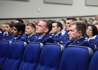 Students of Specialized Undergraduate Pilot Training Class 18-03 listen to Lt. Gen. Richard Clark, 3rd Air Force Commander from Ramstein Air Base, Germany, speak at their graduation ceremony Dec. 15, 2017, at Columbus Air Force Base, Mississippi. Students of 18-03 are now Air Force pilots and will set off on their next assignment. (U.S. Air Force photo by Airman 1st Class Beaux Hebert)