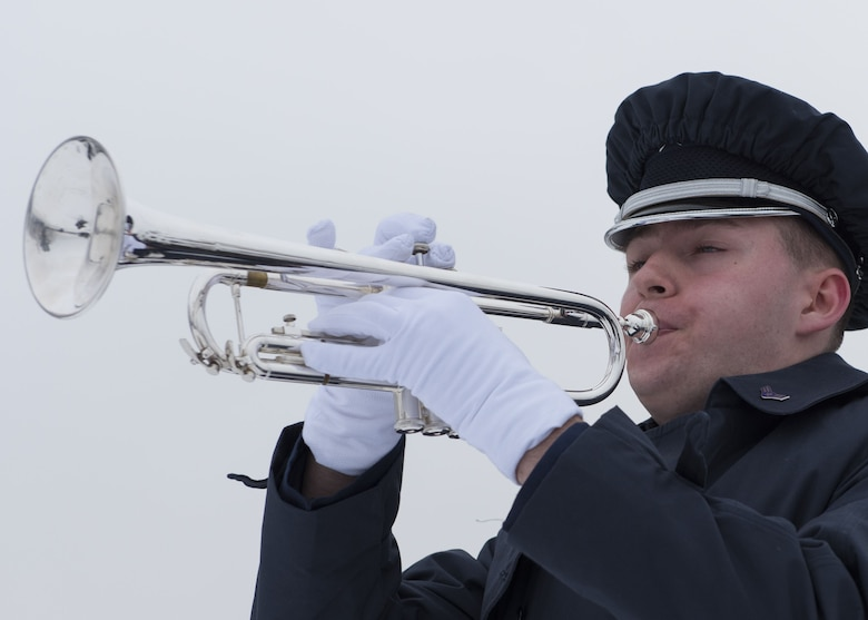 A member of the Fairchild Air Force Base Honor Guard plays taps during an annual wreath laying ceremony at Fort George Wright Cemetery, Washington, Dec. 16, 2017. The playing of Taps began during the American Civil War, where dissatisfied with the standard bugle call, General Daniel Butterfield reworked the melody to the 24-note version still in use today. (U.S. Air Force photo/Senior Airman Ryan Lackey)