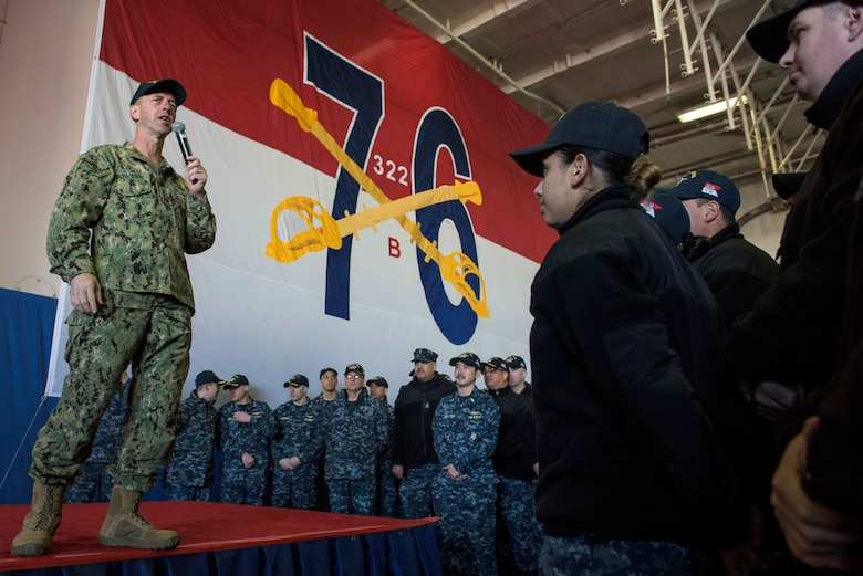 YOKOSUKA, Japan (Dec. 19, 2017) Chief of Naval Operations Adm. John Richardson talks to Sailors during an all-hands call in the hangar bay of the Navy's forward-deployed aircraft carrier, USS Ronald Reagan (CVN 76).