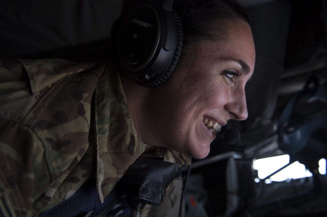 U.S. Air Force Staff Sgt. Rachel Cullen, a boom operator assigned to 447th Air Expeditionary Group, guides the boom of a KC-135 Stratotanker during a refueling mission over Syria, Dec. 1, 2017.