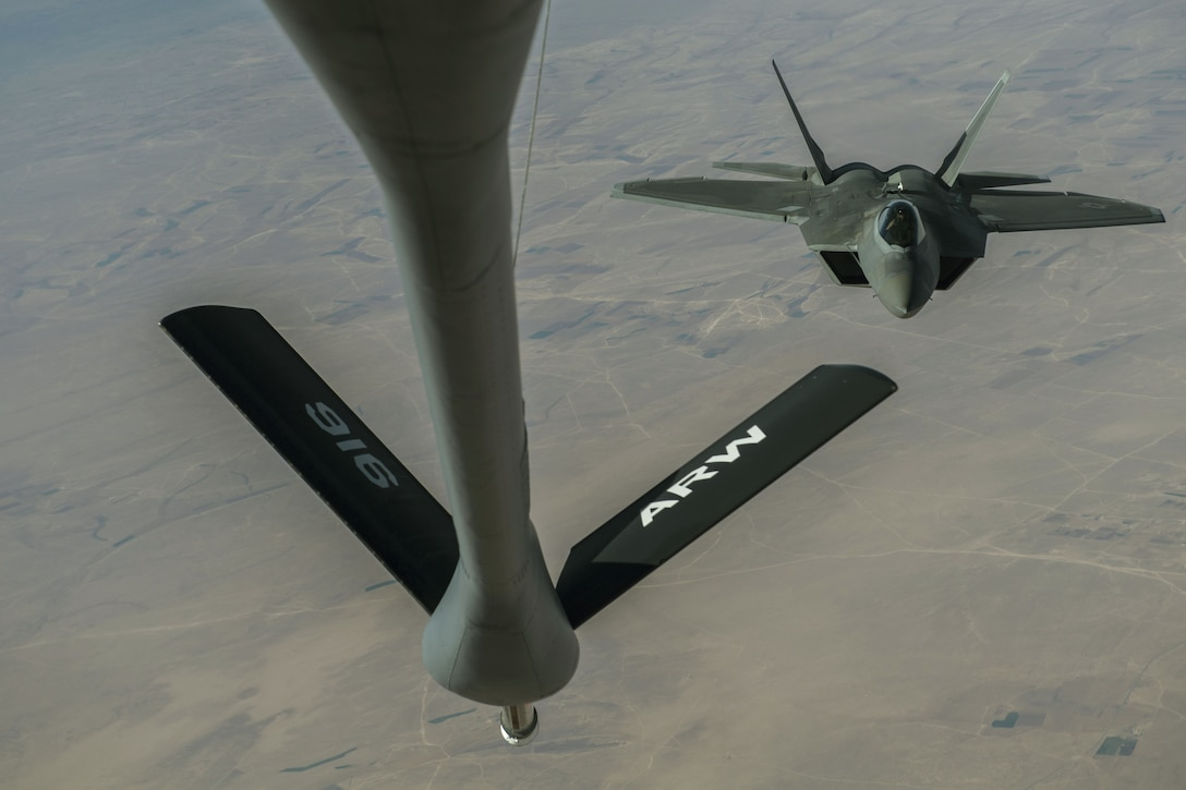A U.S. Air Force F-22 Raptor receives fuel from a KC-135 Stratotanker assigned to the 447th Air Expeditionary Group during a refueling mission over Syria, Dec. 1, 2017.