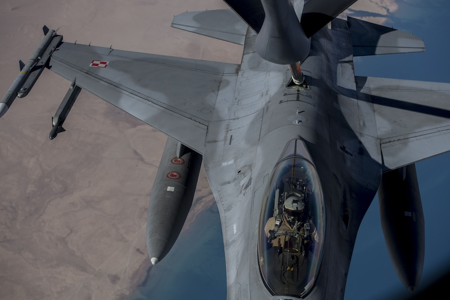 A Polish F-16 Fighting Falcon pilot maneuvers his aircraft into position to receive fuel from a KC-135 Stratotanker assigned to the 447th Air Expeditionary Group during a refueling mission over Syria, Dec. 1, 2017. The Polish Air Force is a military branch of the Polish Armed Forces, as of 2014 it consisted of around 16,425 military personnel and around 475 aircraft distributed among 10 bases throughout Poland. (U.S. Air Force photo by Staff Sgt. Paul Labbe)