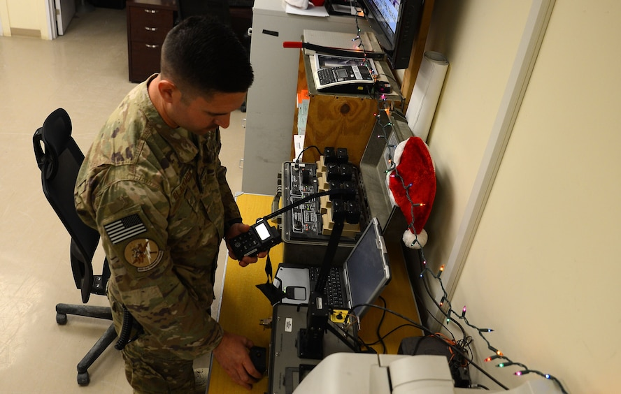 Tech. Sgt. Andrew Blackmon, 430th Expeditionary Electronic Combat Squadron aircrew flight equipment technician, checks the survival radios Nov. 28, 2017 at Kandahar Airfield, Afghanistan.