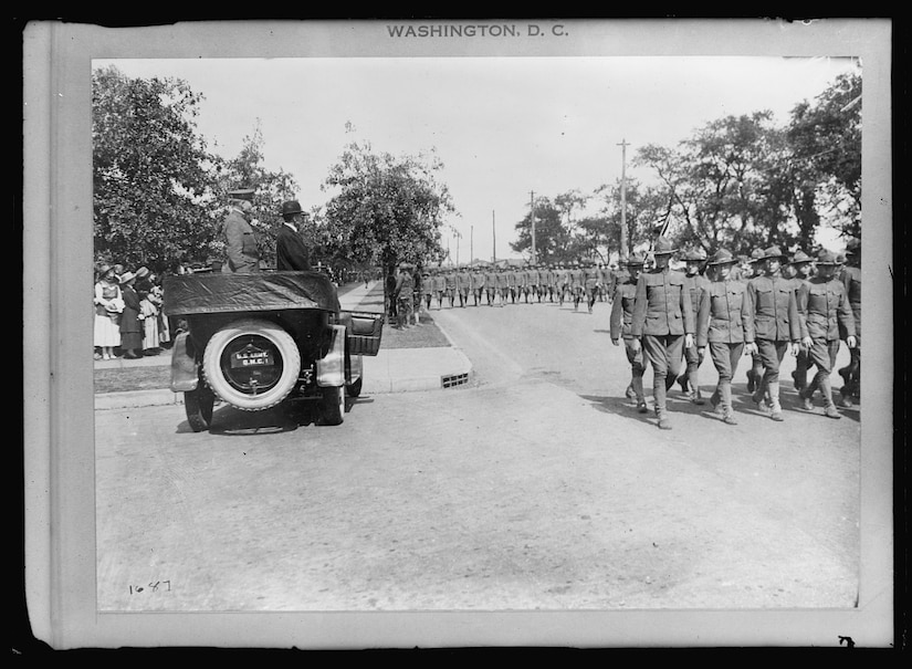 Secretary of War Newton D. Baker and Army Gen. William A. Mann, commander of the 42nd Infantry Division, review the division at Camp Mills, N.Y., in September or October 1917, during preparations for the division's departure to France. Library of Congress photo