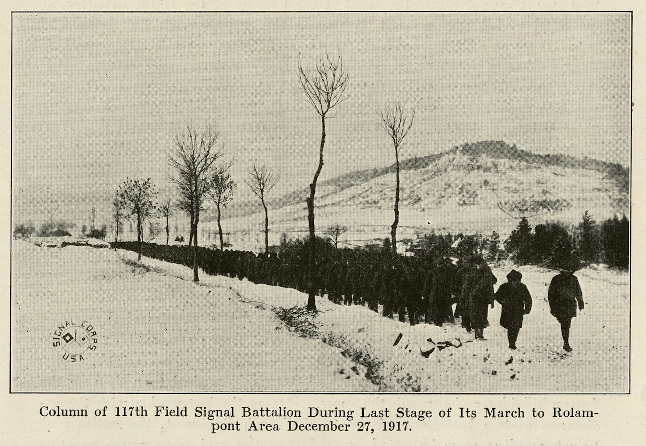 """A photograph from the book """"the Story of the Rainbow Division"""" shows soldiers with the Missouri National Guard's 117th Field Signal Battalion -- part of the 42nd Infantry Division -- making their way through the snowy French countryside in Dec. 1917 during the """"Valley Forge Hike."""" The troops marched over 60 miless in the snow, from Vaucouleurs to Rolampont, France. Courtesy photo"""