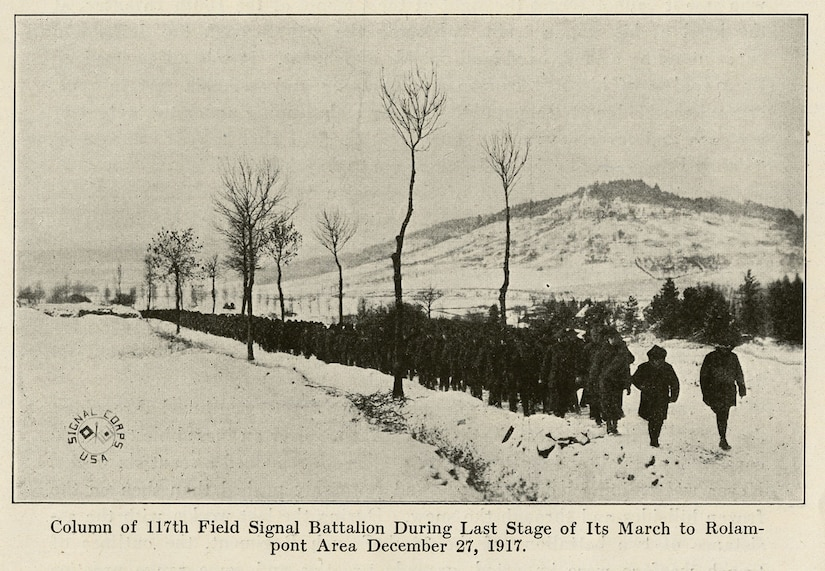 "A photograph from the book ""the Story of the Rainbow Division"" shows soldiers with the Missouri National Guard's 117th Field Signal Battalion -- part of the 42nd Infantry Division -- making their way through the snowy French countryside in Dec. 1917 during the ""Valley Forge Hike."" The troops marched over 60 miless in the snow, from Vaucouleurs to Rolampont, France. Courtesy photo"