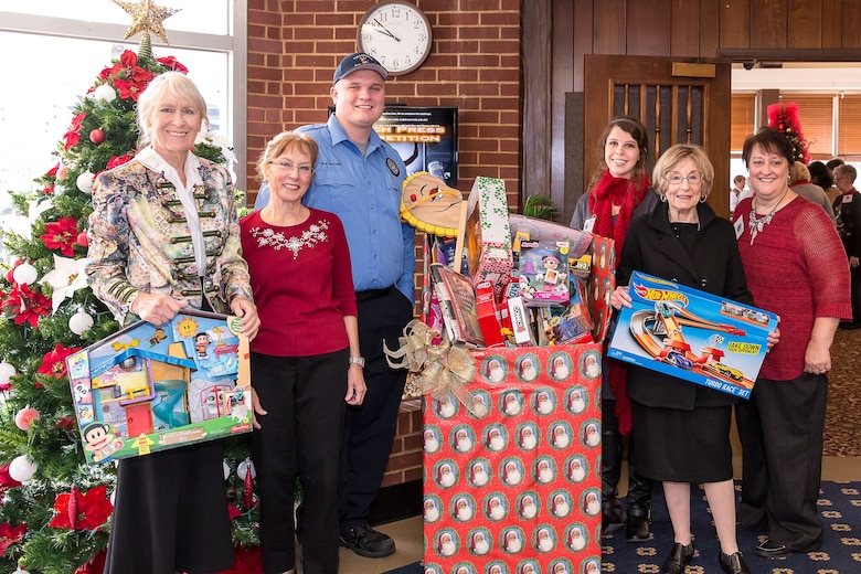 Paul McCown with the Tullahoma Fire Department was in attendance at the AEDC Woman's Club meeting Dec. 7 to collect toys the ladies donated to Toy for Tots. The meeting also featured wonderful singer, Carson Hill, singing Christmas songs. Pictured left to right:  Aggie Alt, Cecelia Schlagheck, McCown, Hill, Ann Jennings and Anne Wonder. (Courtesy Photo)