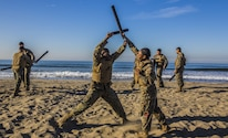 U.S Marines with Headquarters Regiment, 1st Marine Logistics Group, practice Marine Corps Martial Arts Program techniques during a field exercise at Camp Pendleton, Calif., Dec. 14, 2017. The Marines were participating in a Martial Arts Instructors course to earn their instructor tabs, allowing them to teach MCMAP to other Marines in the future.