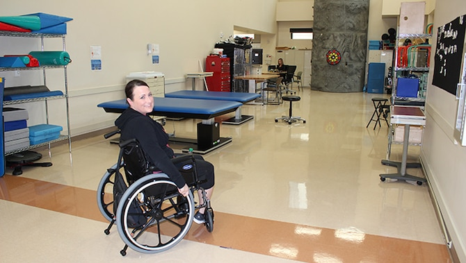 U.S. Air Force Maj. Stephanie Proellochs relies on her wheelchair as she heads in to her daily physical therapy session at Walter Reed Medical Center, Nov. 8, 2017. Proellochs received a below-the-knee amputation in September 2017 to treat a malignant tumor that had metastasized and spread. (U.S. Air Force photo by Karina Luis)