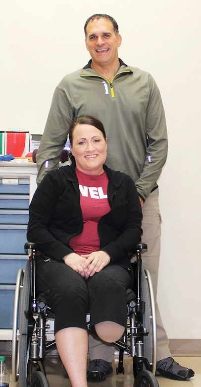 U.S. Air Force Maj. Stephanie Proellochs and her husband, John, before heading for her last physical therapy session before she is fitted for her prosthesis at Walter Reed Medical Center, Nov. 8, 2017. (U.S. Air Force photo by Karina Luis)