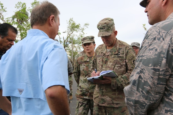 Lt. Gen. Jeffrey Buchanan, commanding general, Joint Force Land Component Command, visits Ramón Luis Rivera, Jr., the mayor of Bayamon, Puerto Rico, to assess the emergency relief efforts needed in Puerto Rico, Oct. 6, 2017. The Department of Defense is supporting the Federal Emergency Management Agency in helping those affected by Hurricane Maria to minimize suffering as part of the overall whole-of-government response efforts. Buchanan is commander of U.S. Army North (Fifth Army) at Joint Base San Antonio-Fort Sam Houston.