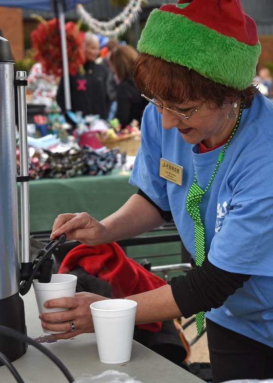 Lisa Morrison, 20th Force Support Squadron employee, prepares a drink for a guest at Frosty Fest, a family-friendly winter celebration, at Shaw Air Force Base, S.C., Dec. 17, 2017.
