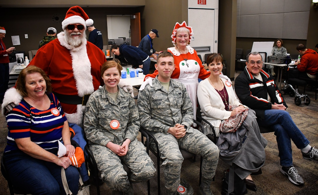"""Multiple wing military Airmen and civilians made a difference by donating their blood inside the 932nd Airlift Wing headquarters on Dec. 14, 2017, at Scott Air Force Base, Ill.  Hanging out and donating with Santa and Mrs. Claus are folks on his updated """"nice list"""" this year.  The Red Cross reminds donors that with each donation, three lives are saved through the American Red Cross processes.  Every two seconds someone in the U.S. needs blood due to accidents, transfusions, and cancer treatments.  Approximately 36,000 units of red blood cells are needed every day in America.  (U.S. Air Force photo by Lt. Col. Stan Paregien)"""