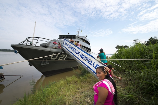 Local villagers board the Brazilian hospital ship.
