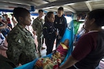 AMAZON RIVER, Brazil (Nov. 22, 2017) Lt. Cmdr. Nehkonti Adams, an infectious diseases specialist, left, and Lt. Gregory Condos, a U.S. Navy internal medicine specialist, middle, work with 2nd Lt. Raissa Vieira Sanchez, a Brazilian medical officer, right, to diagnose an elderly woman on her houseboat near a remote village along the Amazon River in Brazil. Adams and Condos are members of a team of five U.S. Navy doctors who are engaging in a month-long humanitarian mission up the Amazon River. The team is working with the Brazilian Navy to deliver healthcare to some of the most isolated people in the world. (U.S. Navy photo by Mass Communication Specialist 2nd Class Andrew Brame/Released)