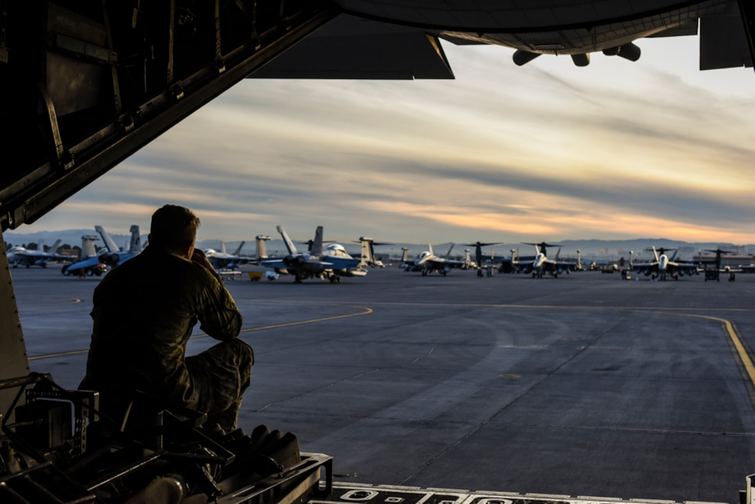 An Air Commando, assigned to the 1st Special Operations Logistic Readiness Squadron, Hurlburt Field, Florida, sits on the ramp of an MC-130H Combat Talon II, assigned to the 14th Weapons Squadron, prior to Coyote Freedom 401, Dec. 12, 2017, at Nellis AFB, Nevada. Coyote Freedom 401 is one of the USAF Weapons School's advanced Special Operations exercise involving dozens of squadrons and aircraft from around the Air Force. (U.S. Air Force photo by Airman 1st Class Andrew D. Sarver/Released)