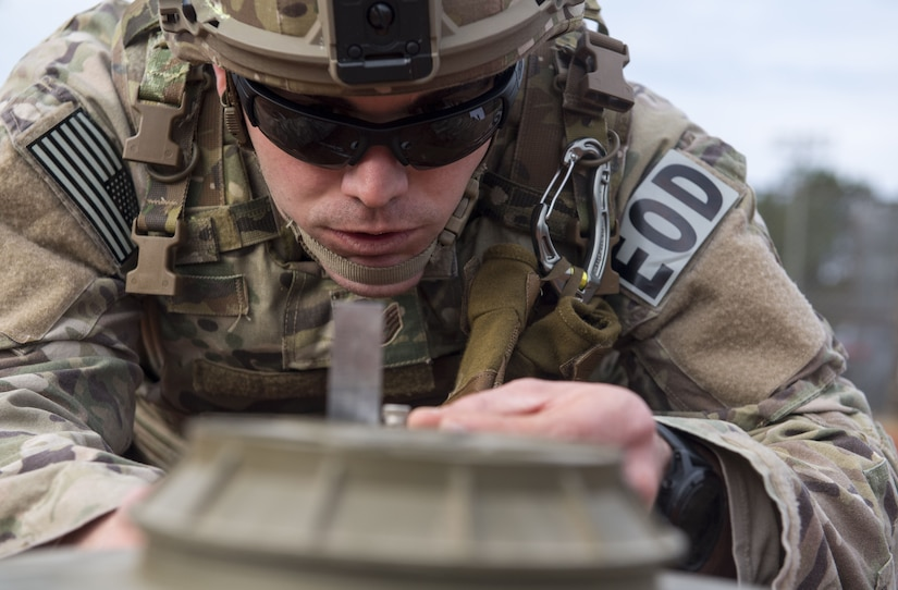 Staff Sgt. Sherwood D. Johnson IV, 628th Civil Engineer Squadron Explosive Ordnance Disposal technician takes measurements while performing a reconnaissance during the EOD Olympics Dec. 15, 2017.