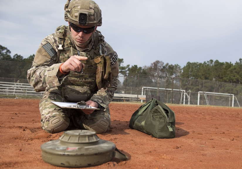 Staff Sgt. Shewood D. Johnson IV, 628th Civil Engineer Squadron Explosive Ordnance Disposal technician performs a reconnaissance during the EOD Olympics Dec. 15, 2017.