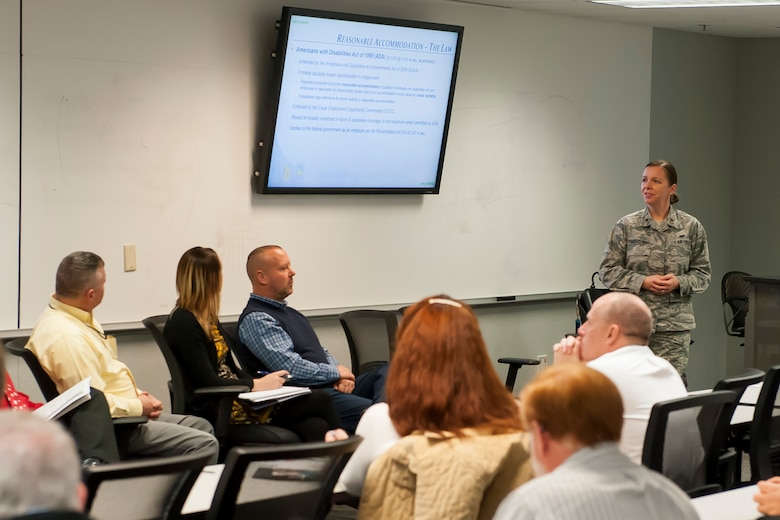 U.S. Air Force Maj. Susan Trepczynski, National Air and Space Intelligence Center staff judge advocate, discusses legal guidelines associated with reasonable accommodations during an open forum Nov. 28, 2017 at Wright-Patterson Air Force Base, Ohio. NASIC leaders held the forum for personnel to speak with different officials about working with people who have disabilities. . (U.S. Air Force photo by Senior Airman Michael Hunsaker/Released)