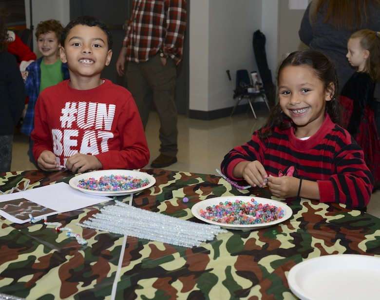 Jadyn, left, and Jazzelli Vargas, children of Michael Colvin, 23d Maintenance Squadron conventional maintenance crew chief, make crafts during a holiday party, Dec. 15, 2017, at Moody Air Force Base, Ga. The Airman and Family Readiness Center hosted the event for families of deployed or remote-tour Airmen, and families enrolled in the Exceptional Family Member Program. During the party, families enjoyed a turkey dinner, played games, made arts and crafts for their loved ones and shared a special moment with Santa Claus. (U.S. Air Force photo by Senior Airman Lauren M. Sprunk)