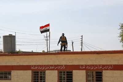 An Iraqi federal police officer provides security for students at a primary school in Aski Mosul, Iraq, Nov. 13, 2017. Army photo by Army Sgt. Tracy McKithern