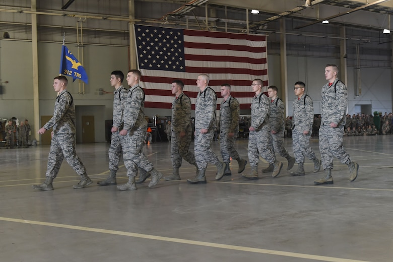 The 312th Training Squadron drill team performs their routine during the regulation drill segment during the 17th Training Group drill competition at the Louis F. Garland Department of Defense Fire Academy on Goodfellow Air Force Base, Texas, Dec. 15, 2017. The regulation drill segment was the first of the three judged events in the drill competition. (U.S. Air Force Photo by Airman 1st Class Zachary Chapman/Released)