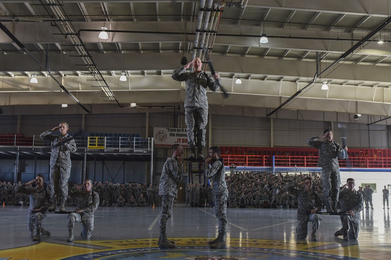 The 316th Training Squadron drill team addresses the judge at the end of their regulation drill segment during the 17th Training Group drill competition at the Louis F. Garland Department of Defense Fire Academy on Goodfellow Air Force Base, Texas, Dec. 15, 2017. The 316th TRS finished off their routine with a display of skill and balance. (U.S. Air Force Photo by Airman 1st Class Zachary Chapman/Released)
