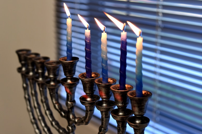 The Menorah after five of the eight candles are lit for the ceremony on Goodfellow Air Force Base, Dec. 15, 2017. Throughout the eight days of Hanukkah the lights are considered sacred and only to be looked at as an offer in thanks and praise. (U.S. Air Force photo by Airman 1st Class Seraiah Hines/Released)