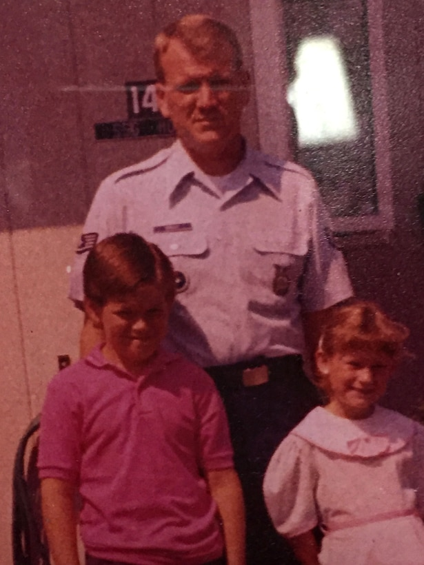 U.S. Air Force Staff Sgt. Ronald Hoelle with his two children at Chanute Air Force Base, Illinois, where he instructed. (Courtesy photo used with permission.)