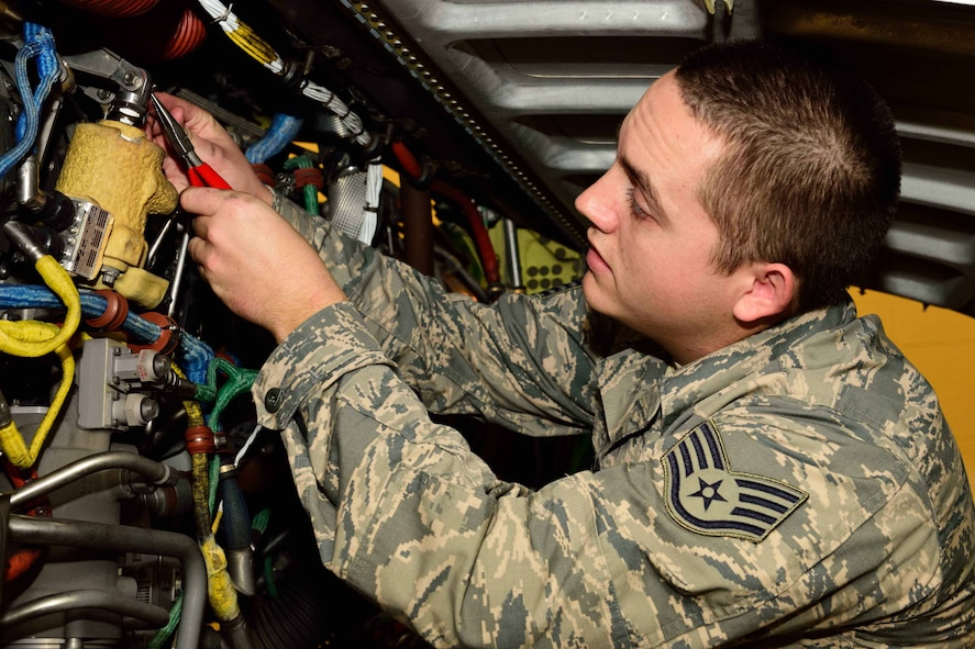 "Staff Sgt. John Douglas, 403rd Aircraft Maintenance Squadron propulsion technician, reinstalls a compressor variable guide vane actuator, which controls air flow to the engine of a WC-130J Super Hercules aircraft, at Keesler Air Force Base, Mississippi, Dec. 19, 2017. The 403rd AMXS maintains the aircraft flown by the 53rd Weather Reconnaissance Squadron ""Hurricane Hunters"" here. (U.S. Air Force photo by Tech. Sgt. Ryan Labadens)"