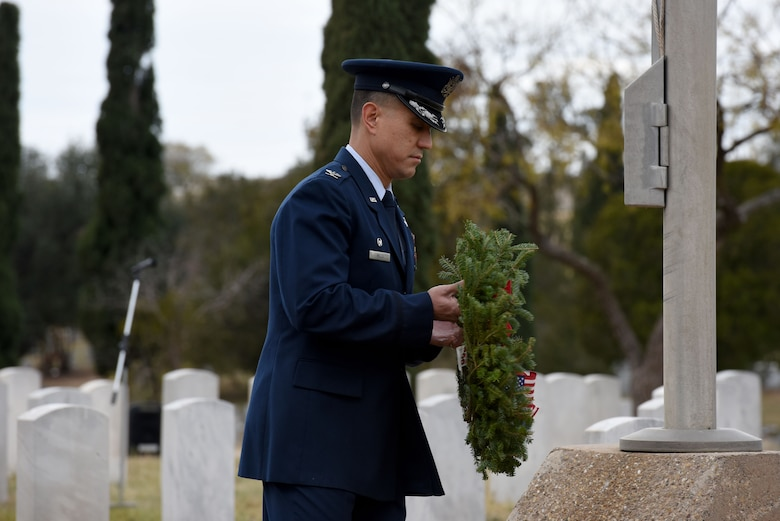 U.S. Air Force Col. Ricky Mills, 17th Training Wing commander, lays a symbolic wreath representing all those who have served in the Air Force at the Wreaths Across America ceremony, at Belvedere Memorial Park, San Angelo, Texas, Dec. 16, 2017. Mills was one of several commanders and active duty members to lay a wreath to represent their branch of service and honor all who have served. (U.S. Air Force photo by Airman 1st Class Seraiah Hines/Released)
