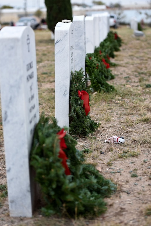 Wreaths line the headstones of veterans after the ceremony at Belvedere Memorial Park, San Angelo, Texas, Dec. 16, 2017. The wreaths were used to show honor and to remember all that the different members of different branches have done for our country. (U.S. Air Force photo by Airman 1st Class Seraiah Hines/Released)
