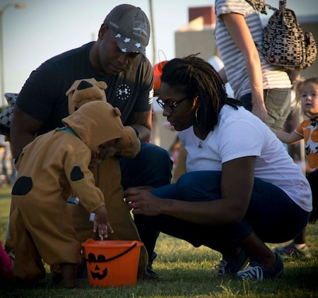 Active duty military members, DoD personnel and their families enjoy candy, games, and Halloween decorations during the third annual Trunk or Treat event held on the parade deck aboard Marine Corps Air Station Yuma, Ariz., Oct. 26, 2017. The event is a collaborative effort between the Alcohol Abuse Prevention Program, the Sexual Assault Prevention Program, the Drug Demand Reduction Program, and Marine Corps Family Team Building in honor of Red Ribbon Week. (U.S. Marine Corps photo by Lance Cpl. Joel Soriano)