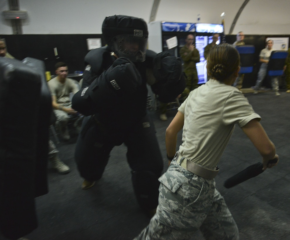 """Senior Airman Haley Baraby, 380th Expeditionary Security Forces, maneuvers away from the """"Redman"""" during the ASP Baton training at Al Dhafra Air Base, United Arab Emirates Dec. 1, 2017. During this training members have the opportunity to demonstrate defense techniques using the ASP Baton against opponents dressed in redman gear.   (U.S. Air Force photo by Tech. Sgt. Anthony Nelson Jr)"""