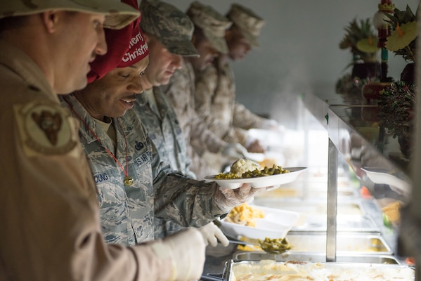 Leadership from the 407th Air Expeditionary Group serve a Christmas meal to the Airmen and Marines deployed under their charge in Southwest Asia, Dec. 25, 2016. The service members deployed here are supporting Operation Inherent Resolve.