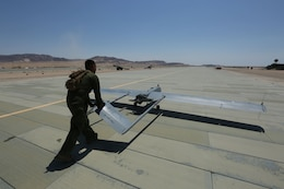 Lance Cpl. Miguel Salazar, an unmanned aerial vehicle technician with Marine Unmanned Aerial Vehicle Squadron 4, Marine Aircraft Group 41, 4th Marine Aircraft Wing, Marine Forces Reserve, returns an RQ-7 Shadow to the VMU-4 hanger at Camp Wilson, Marine Air Ground Combat Center, Twentynine Palms, California, June 22, 2017. VMU-4 provided aerial reconnaissance in support of the 2nd Battalion, 25th Marine Regiment, 4th Marine Division, MARFORRES final battalion exercise of ITX 4-17.
