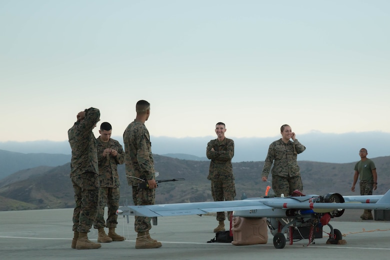 U.S. Marines with Marine Unmanned Aerial Vehicle Squadron 4, Marine Aircraft Group 41, Marine Forces Reserve prepare to launch the RQ-7 Shadow Tactical Unmanned Aircraft System on Camp Pendleton, Calif., August 19th, 2017. The RQ-7 is helping VMU-4 make history as it is utilized to conduct yearly surveys of deer and buffalo populations on the base, a job formerly tasked to manned helicopters. In addition to offering a low-cost solution to conducting wildlife surveys, the exercise also provides valuable training to Marines who are learning to use the UAVs for aerial reconnaissance in areas of conflict.