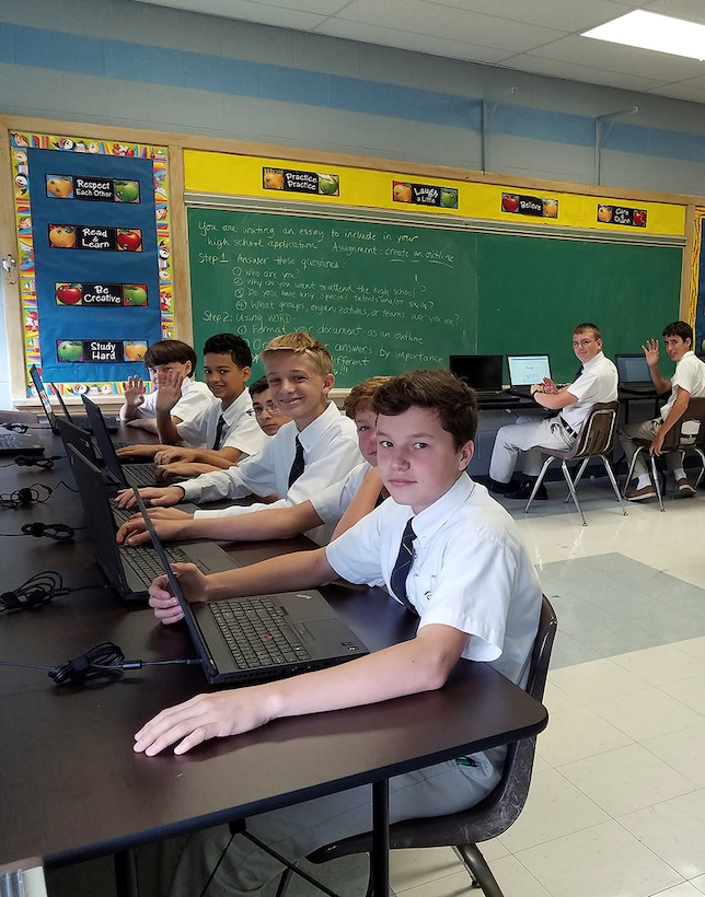 Students at St. Kevin School in Providence, Rhode Island, test new laptop computers donated from a command at nearby Quonset Air National Guard Base. Computers for Learning allows DLA to help public, private and parochial schools and educational non-profits acquire used and excess DoD information technology free of charge.