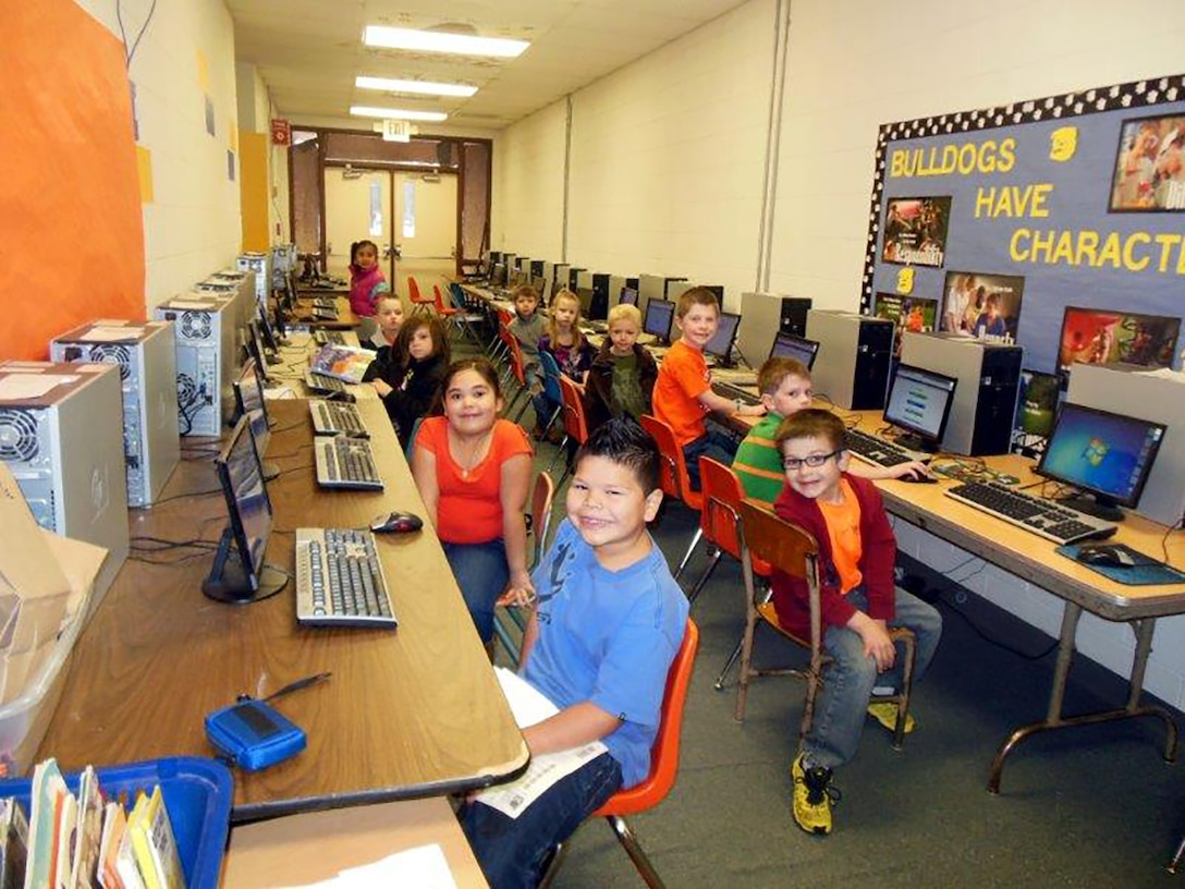 Elementary students in Drummond, Oklahoma, work in their new computer lab. Their district acquired 114 desktop units from Vance Air Force Base via DLA. Older students installed operating systems, drivers, software and network switches to prepare the machines for reuse.