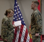 Marine Corps Lt. Col. Taunja M. Menke, left, commanding officer of the Ground Supply School, Marine Corps Combat Service Support Schools awards 2nd Lt. Spencer Preston, right, a student attending the Ground Supply Officer Course with the Navy and Marine Corps Achievement Medal at Camp Johnson, N.C., Dec. 8, 2017. Preston was recognized for rescuing a fellow Marine involved in a motorcycle accident. Marine Corps photo by Lance Cpl. Tyler Pender