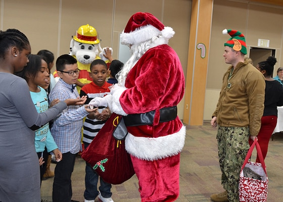 Santa passes out candy canes to students