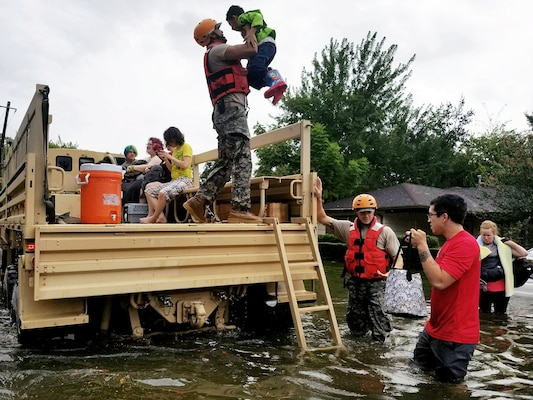 Members of the Texas National Guard in Houston  rescue stranded residents in flooded areas from the storms of Hurricane Harvey.