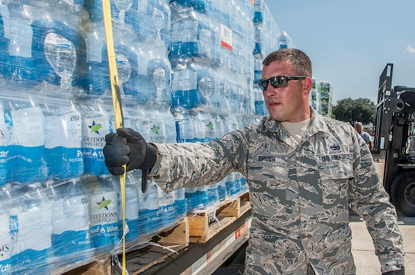 Air Force Staff Sgt. James Brush, 502nd Logistics Readiness Squadron, prepares over 30,000 water bottles for transport at Joint Base San Antonio-Lackland, Texas, as part of Hurricane Harvey relief. DLA Troop Support provided 1.5 million bottles of water and 18 million meals to FEMA in support of the relief efforts.
