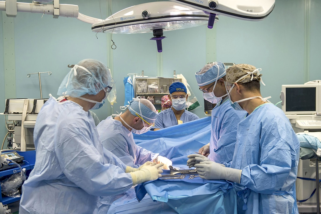 Sailors perform a surgical operation in an operating room aboard the hospital ship USNS Comfort in the Caribbean Sea. The Comfort is providing medical services to people affected by Hurricane Maria, with supply support from DLA.