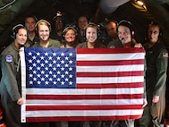 Members of the 932nd Airlift Wing's Aeromedical Evacuation Squadron flew a special retirement flag for their former member, Chief Master Sgt. Heather Braundmeier, aboard a KC-135 training flight Dec. 16, 2017.  Braundmeier previously served as a 932nd AES administrator, 932nd Airlift Wing flight attendant, and was a 932nd Squadron Aviation Resource Manager before transferring to the Air National Guard where she serves as part of the medical group. The flight featured aircrew support from the 507th Air Refueling Wing out of Tinker Air Force Base, Oklahoma.  The 932nd Airlift Wing is located at Scott Air Force Base, Ill., and is a 22nd Air Force unit, under the Air Force Reserve Command.  (U.S. Air Force photo by Lt. Col. Stan Paregien)
