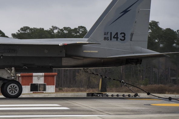 The tail hook on an F-15C Eagle catches the cable of an arresting system, Dec. 19, 2017, at Moody Air Force Base, Ga. The BAK-12 arresting system is used on the runway to slow down fighter aircraft in emergency situations. (U.S. Air Force photo by Senior Airman Janiqua P. Robinson)